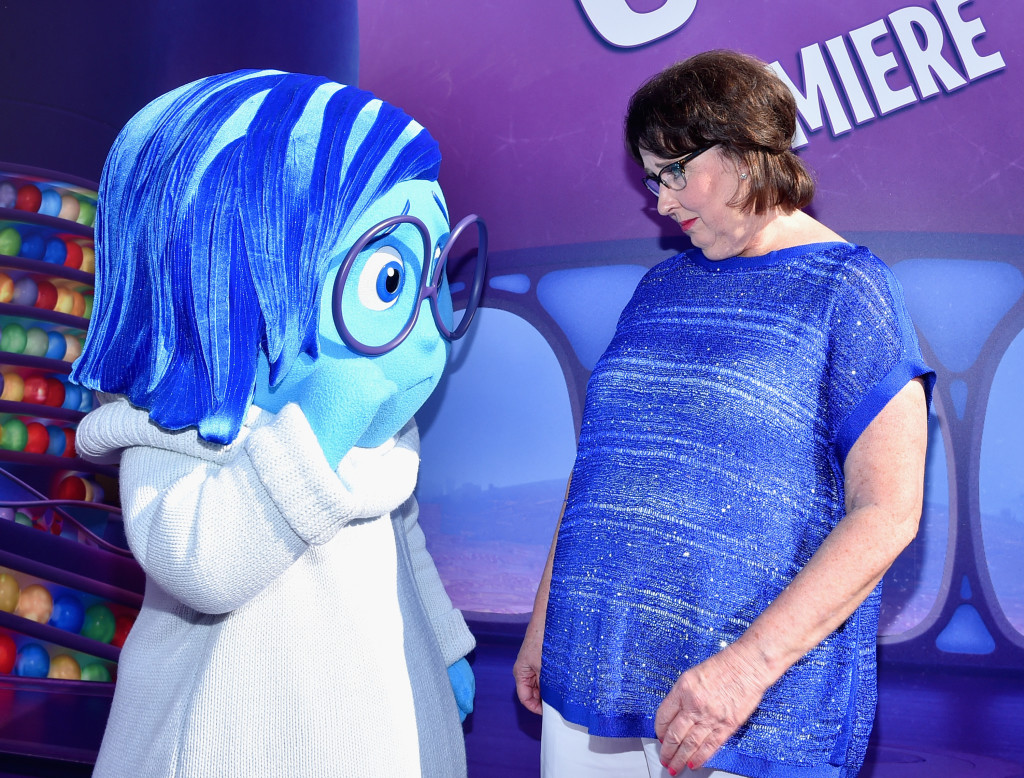 HOLLYWOOD, CA - JUNE 08: Sadness (L) and actress Phyllis Smith attends the Los Angeles Premiere and Party for Disney?Pixar?s INSIDE OUT at El Capitan Theatre on June 8, 2015 in Hollywood, California.  (Photo by Alberto E. Rodriguez/Getty Images for Disney) *** Local Caption *** Sadness; Phyllis Smith