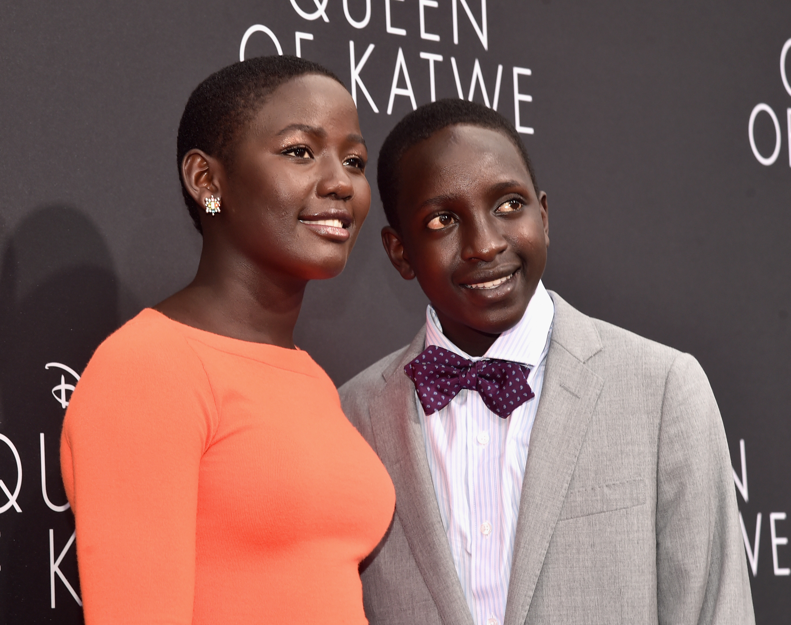 "HOLLYWOOD, CA - SEPTEMBER 20: Actors Madina Nalwanga (L) and Martin Kabanza arrive at the U.S. premiere of Disney's ""Queen of Katwe"" at the El Capitan Theatre in Hollywood. The film, starring David Oyelowo, Oscar winner Lupita Nyong'o and newcomer Madina Nalwanga, is directed by Mira Nair and opens in U.S. theaters in limited release on September 23, expanding wide September 30, 2016. On September 20, 2016 in Hollywood, California. (Photo by Alberto E. Rodriguez/Getty Images for Disney) *** Local Caption *** Madina Nalwanga; Martin Kabanza"